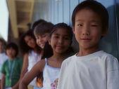 Group portrait of children standing in line — Stock Photo