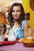 Portrait of woman sitting in restaurant — Stock Photo