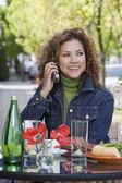 Hispanic woman talking on cell phone — Stock Photo
