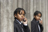 Male students talking on their cell phones — Stock Photo