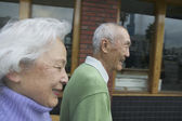 Side view of senior couple walking — 图库照片
