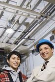 Man and woman together in warehouse — Stock Photo