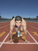 Male track athlete at the starting line — Stock Photo