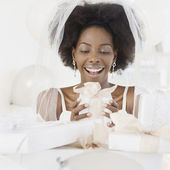 African bride opening gifts — Stock Photo