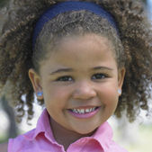 Close up of young African girl smiling — Stock Photo