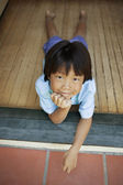 Young boy laying on porch — Stock Photo