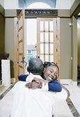 Girl hugging man at home — Stock Photo