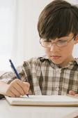 Greek boy doing homework — Stock Photo