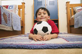 Portrait of young boy with soccer ball — Stock Photo