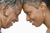 Close up profile of mother and daughter looking at each other — Stock Photo