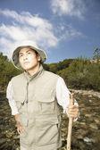 Explorer walking through riverbed — Stock Photo