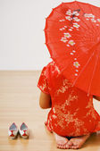 Asian woman in traditional clothing with parasol — Stock Photo