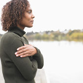 Profile of woman standing by lake — Stock Photo