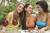 Three young women sitting together — Stock Photo