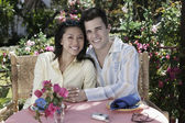 Couple hugging at outdoor table — Stock Photo