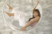 Young woman sitting in a plastic bubble — Stock Photo