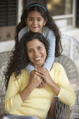 Portrait of mother and daughter smiling — Stock Photo