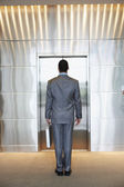 Businessman waiting for elevator — Stock Photo