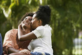 South American couple kissing in park — Stock Photo