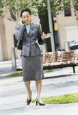 Businesswoman outdoors using mobile phone — Stock Photo