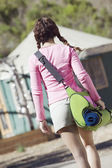 Rear view of woman walking with camping bag — Stock Photo