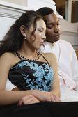 Teenage couple asleep at formal dance — Stock Photo