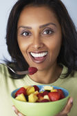 Asian woman eating fruit salad — Stock Photo