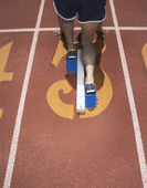 Rear view of track athlete at starting line — Stock Photo