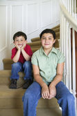 Portrait of brother and sister sitting on stairs — Stock Photo
