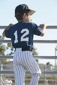Rear view of boy watching baseball game — Stock Photo