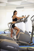 Woman exercising at health club — Stock Photo