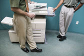 Low section of two businessmen at copy machine — Foto Stock