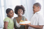 African American mother and children with birthday cake — Stock Photo