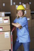 Female warehouse worker with hard hat — Stock Photo