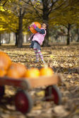 African girl carrying pumpkin — Foto Stock