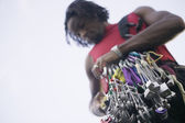 Low angle view of man with climbing equipment — Stock Photo
