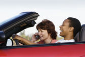 Female friends in convertible — Stock Photo