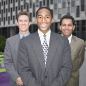 Businessmen smiling — Stock Photo
