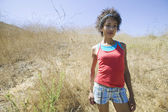 African American woman standing outdoors — Stock Photo