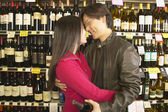 Asian couple hugging in grocery store — Stock Photo