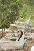 Young woman lying on hammock — Stock Photo
