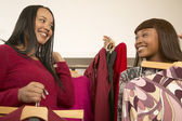 Two African American women shopping for clothes — Stock Photo