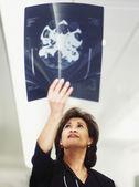 Female doctor examining x-rays — Stock Photo