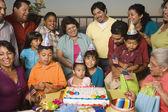Large Hispanic family celebrating birthday — Stock Photo