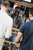African man shopping for sunglasses — Stock Photo