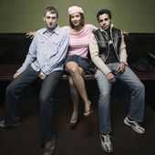 Group portrait of woman with two men — Stock Photo