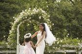 Hispanic bride and young girl dancing in circle — Stock Photo