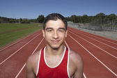 Portrait of male track participant — Stockfoto