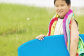 Portrait of boy with body board — Stock Photo