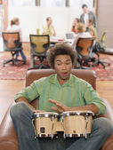 Young man playing drums — Stock Photo